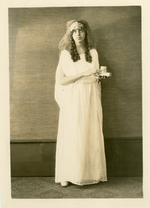 Unidentified young woman in long gown and headpiece