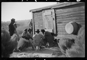 Negroes shooting craps behind tenant house, disposing of their cotton money on Saturday afternoon, Marcella Plantation, Mississippi Delta, Mississippi