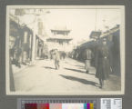 Pedestrians and soldier on city street, Shenyang, 1909