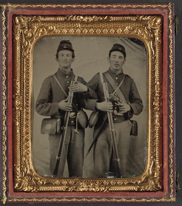 [Two unidentified soldiers in Union uniforms with Model 1809 Prussian bayoneted muskets and Model 1858 cloth-covered canteens]