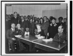 """[Eleanor Roosevelt, seated at microphone at radio station WOL, Washington, D.C., presenting a """"My people"""" program, devoted to African Americans]"""