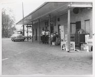 Mississippi State Sovereignty Commission photograph of two men leaving the rear entrance to Stanley's Cafe, Winona, Mississippi, 1961 November 1