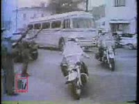 WSB-TV newsfilm clip of Alabama National Guardsmen protecting an interracial group of Freedom Riders as they arrive at the Greyhound bus terminal in Montgomery, Alabama, 1961 May 24