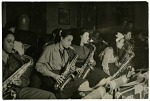 """[""""Sweethearts"""" practice session: saxophone section. Black-and-white photoprint.]"""