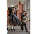 Barber Giving Haircut to Child