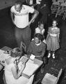 Photograph of school registration, Glenn Elementary School, Cleveland Street, Nashville, Tennessee, 1957 August 27