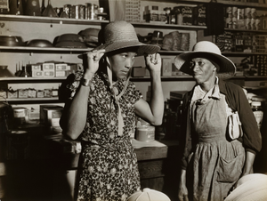 Trying on a new straw hat in Mr. M. W. Lipford's general store in Franklin, Heard County, Georgia