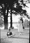 Lillian Evanti [Lillian Evans Tibbs] and son [Thurlow Tibbs] in park, #97 [cellulose acetate photonegative, ca. 1930-1940]