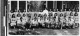 Group portrait of Sister M. Aquinata, MM, and catechists, Malabon, Philippines, April 1949