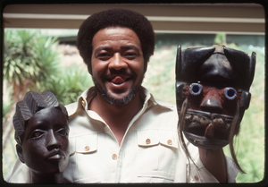 Bill Withers: Withers posing with an African bust and mask