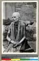 Hindu man putting his foot over his shoulder to seek religious merit, Vārānasi , India, ca. 1920