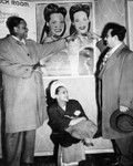 Singer with publicity poster