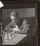 [Officer in 332nd Fighter Group playing chess in officers' club at air base in southern Italy]