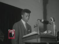 WSB-TV newsfilm clip of Wyatt T. Walker, Dr. Martin Luther King, Jr., and an unidentified young man speaking at a mass meeting, Augusta, Georgia, 1962 April 3