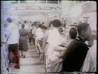 WSB-TV newsfilm clip of African Americans protesting segregation by conducting a lunch counter sit-in, possibly in Oklahoma City, Oklahoma, 1958