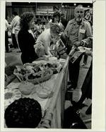 Michelle Ward Talks to Kris Freeman, Trudy Gill and Russell Wachsmann at the Engelman's Bakery Booth, October 8, 1987