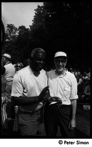 Jackie Robinson (left) with unidentified man at Robinson's summer jazz concert