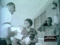 Blacks Canvassing Black Neighborhood to Encourage People to Register to Vote (No Date)
