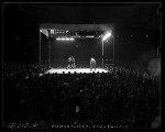 Joe Louis vs Jack Roper boxing match with surrounding crowd at Wrigley Field, Los Angeles, Calif, 1939