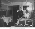 Waiter setting table in North Coast Limited dining car, Seattle, 1947