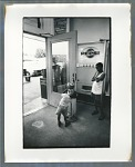 Young boy at gumball machine