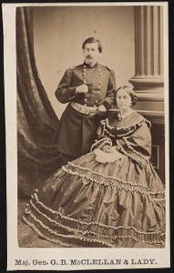 [Major General George Brinton McClellan of General Staff U.S. Volunteers Infantry Regiment, in uniform standing beside his wife, Mary Ellen McClellan, in front of painted backdrop]