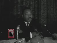 WSB-TV newsfilm clip of Dr. Martin Luther King, Jr. speaking to reporters during the Southern Christian Leadership Conference's annual convention, Savannah, Georgia, 1964 October 1
