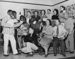 Thumbnail for Group singing around piano includes three people in blackface, Seattle Civic Opera-Moonlight Cabaret Minstrels, 1951