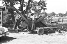 African American man with farm equipment
