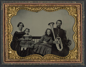 [Unidentified soldier in Union uniform with wife and daughters holding saxhorn]