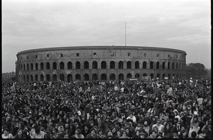 Anti-war rally at Soldier's Field, Harvard University: crowd in front of Harvard Stadium, 'Free Bobby Seale' sign in background
