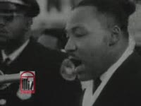 Thumbnail for WSB-TV newsfilm clip of Dr. Martin Luther King, Jr. speaking about freedom and the civil rights movement at an outdoor rally held in Atlanta, Georgia, 1963 December 15