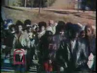 WSB-TV newsfilm clip of students at the University of Georgia marching on campus and meeting with university president Fred Davison in an attempt to gain university support for African American students on campus, Athens, Georgia, 1974 February 26