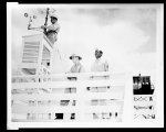Thumbnail for Weather observation Members of the weather detachment in the process of making their daily weather observations. Lt. Wallace P. Reed, Chief Weather Officer, takes the morning temperature reading while one of his assistants climbs aloft to adjust the anemometer.