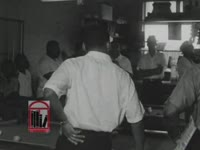 WSB-TV newsfilm clip of civil rights leaders promoting nonviolence in a poolroom in Albany, Georgia, 1962 July 25