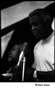 Jackie Robinson at the microphone, holding a bust of Martin Luther King