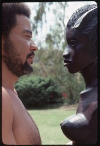 Bill Withers: Withers shirtless and in profile facing an African bust