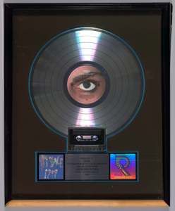 Platinum Record Award for the album 1999 given to Prince