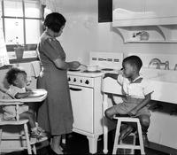 Housing; Blighted Areas; Detroit; Brewster Housing Project. Interior views showing colored family in apt...