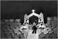 """Photographer on stage, shooting a scene from the morality play """"Heaven Bound,"""" staged by the Big Bethel African Methodist Choir, at the Atlanta Theatre (23 Exchange Place), Atlanta, Georgia, August 1937"""