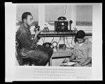Thumbnail for Control tower High in the air overlooking the field and surrounding terrain men such as these guide and direct the air traffic at the Tuskegee Army Air Field.