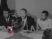 WSB-TV newsfilm clip of a press conference with comments by Dr. Martin Luther King, Jr. about the Freedom Ride, Montgomery, Alabama, 1961 May 23