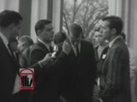 WSB-TV newsfilm clip of students debating integration at the University of Georgia following the court-ordered admission of African American students Charlayne Hunter and Hamilton Holmes in Athens, Georgia, 1961 January