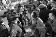 African American crowd and police officers during a civil rights march in Social Circle, Georgia, February 20, 1982