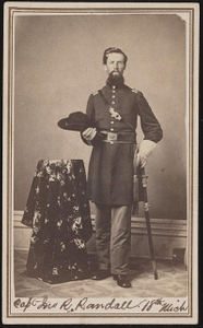 [Captain John R. Randall of Co. C, 7th Michigan Infantry Regiment and Co. G and Co. F, 18th Michigan Infantry Regiment in uniform with sword]