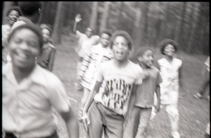 Inner City Round Table of Youth campers: group of African American children at summer camp, running toward camera (blurry)