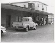 Mississippi State Sovereignty Commission photograph of three vehicles parked outside the rear entrance to Stanley's Cafe and the Trailways bus depot, Winona, Mississippi, 1961 November 1