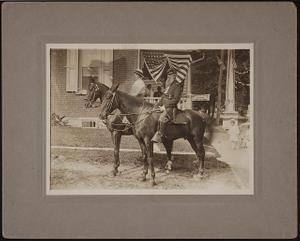 [Civil War veteran Joseph Matchette in uniform with medals and his aide, Mrs. Minnie Lazarus, on horseback]