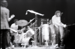 Miles Davis in performance: full shot of the band in action including Dave Liebman, Cedric Lawson, Reggie Lucas, Michael Henderson, Al Foster, Miles Davis, James Mtume, Badal Roy, and Khalil Balakrishna (image damaged)