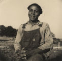 Ploughman, sitting on fence after day's work in Eutaw, Alabama.